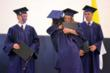 Everest graduates congratulate each other as they receive their diplomas.